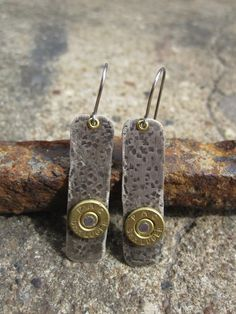 Artist Cheri Lesauskis creates jewelry from unusual objects such as these bullet-rim earrings