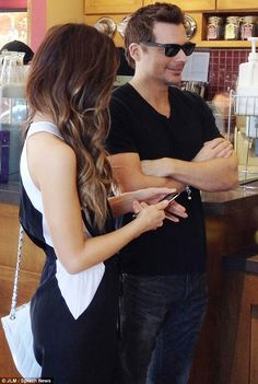 What's in the news? Len, 40, smiled as his beautiful wife checked her smart phone...