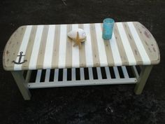 coastal themed coffee table recycled item painted stripes and anchoradds a coastal charm with a shelf for storing your pillows or quilts beach theme furniture 1000