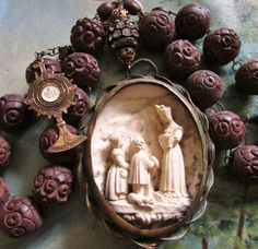 Antique meerschaum French -carved wood rosary beads. features Holy Eucharist in monstrance and cameo of the Virgin of La Salette