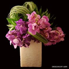 Purple and pink Orchids + Grasses - Designs by Ahn #purple #orchidcenterpiece #wedding