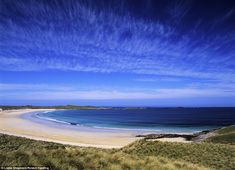 Tropical colours in May at the crescent-shaped Feall Beach on the Island of Coll, in the Inner Hebrides of Scotland
