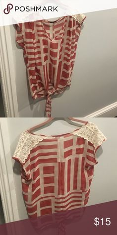 Pattern silk shirt with lace detail Burnt sienna pattern top with cream lace detail at shoulders. Key hole waist. ellus Tops Blouses