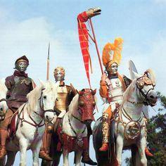 Roman cavalry reenactors, one holding a draco