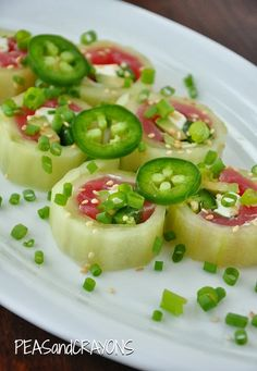Cucumber Wrapped Sushi Rolls! Would like to try this without the fish. Probably could fill with all sorts of good stuff!