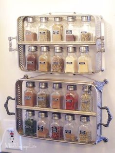 Vintage silver plate casserole/serving dishes holders made into spice jar racks, hung on the wall.