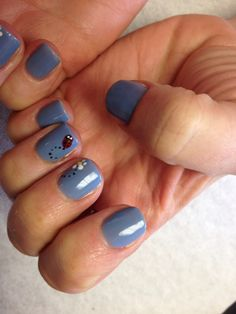 Blue with lady bug and daisy design on accent nails  Oasis Salon and Spa Mill Hall Pa (570)726-6565