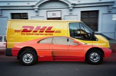 Image of Red sports car Graphics applied to DHL Delivery Truck shows very Clever Advertising