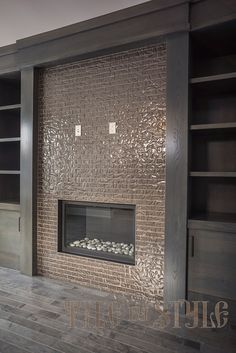 Glass fireplace tiles Glass fireplace tiles. Photo posted by Tile By Style located in Calgary