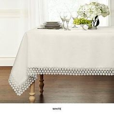 6. Ultra Luxurious Textured Macrame Trim Tablecloth