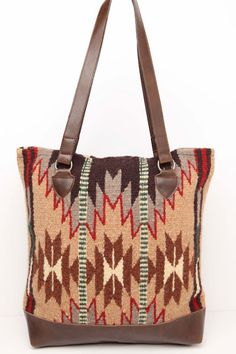 """Handwoven 100% Wool panels in classic Zapotec styles and eye catching colors with  Durable Grade 'A' soft faux leather bottom, comfortable sturdy handles. Zipper closure, fully lined with an inside pocket Approx 15"""" X 16"""""""