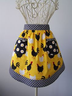 Cute Chicken and Rooster Farmhouse Half Apron in Yellow and Black with Fried Egg Pockets. $34.00, via Etsy.