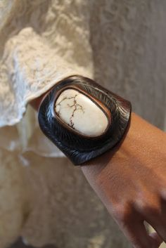 Badass stone and leather cuff. So awesomely west coast tribal I could puke.