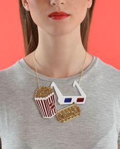 Cinema necklace. Laser cut and handmade by La Vidriola. #popcorn #popcornpackage #cinema #film #acrylicjewellery #acrylic #hulahoop #lavidriola #mirror #perspex #retro #vintage