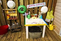 Mud Pie station play area - equipped wiht every possible mud pie element you could ever need. This is fab.