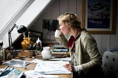 i want to be in this point in life. sipping coffee while drawing & painting beautiful work, having a vast space to work on; art supplies aplenty at your reach, looking elegantly natural, all while overlooking something grand. (here it's the ocean). Brita Granström illustrates children's books...another dream. Photographed by Diana Pappas.