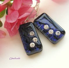 These unusual blue violet, deep purple, handmade earrings are created with fused dichroic glass  imbedded with triplets of brilliant cubic zirconia in each earring.  The rectangular earrings are a dee