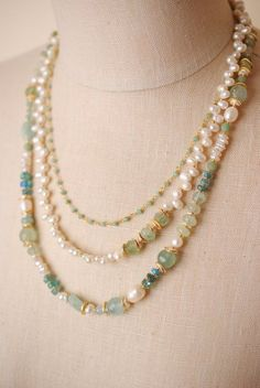 A light and airy blend of fluorite, pearl and amazonite is blended with sterling silver and gold filled in a triple multi strand. An amazonite focal wrapped in a gold filled herringbone weave complet