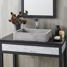 Nipomo concrete sink is handcrafted of NativeStone®, an innovative, remarkably strong blend of cement and jute fiber that is surprisingly lightweight for concrete, extraordinarily heavy-duty in the bathroom and refreshingly easy when it comes to clean-up. Available in three finishes: Ash, Slate, and Pearl.