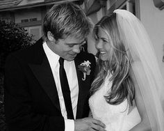 Jennifer Aniston and Brad Pitt It's not so much Aniston's beaded halter-neck dress (designed by Lawrence Steele) but radiant smile and signature glossy locks which catch the eye in the only picture of her wedding to Pitt in 2000.