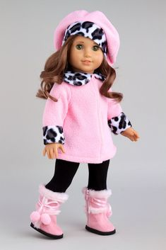 Elegant pink fleece coat with animal prints cuffs and collar matched with a beautiful beret, black leggings and pink boots. - Our doll clothes fits 18 inch American Girl dolls. - Designed in the USA a