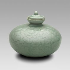 """Covered Oil Bottle with Flowering Lotus and Scrolling Leaves Goryeo dynasty 12th century "" From the Art Institute of Chicago."