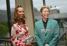 Singer David Bowie (R) and his wife model Iman stand backstage at The Film Society of Lincoln Center's Tribute to Susan Sarandon at Avery Fisher Hall May 5, 2003 in New York City. (Photo by Evan A
