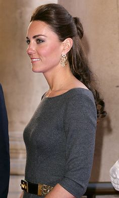 At a museum launch reception, Kate wore her hair in her signature half-updo to show off her gorgeous Cassandra Goad Temple of Heaven earrings, which matched her gold belt.