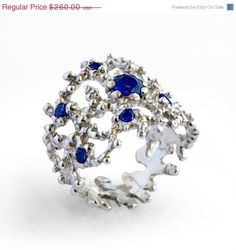 SALE 20% Off - CORAL Blue Sapphire Ring, Sterling Silver Sapphire Ring, Statement Ring, Wide Silver Ring, Blue Stone Ring by AroshaTaglia on Etsy https://www.etsy.com/listing/181942226/sale-20-off-coral-blue-sapphire-ring