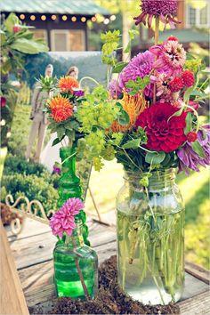 wildflower arrangements mason jar wedding decor / http://www.deerpearlflowers.com/cheap-mason-jar-wedding-ideas/