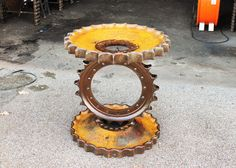 Made from industrial large metal gears reclaimed oak from house over 100 years old.    Measures 28 inches tall x 25 inches wide Buyer pays