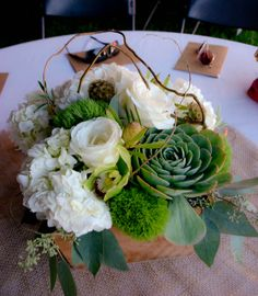 rustic wooden box centerpiece filled with hydrangeas, orchids, succulents, roses, scabiosa pods, seeded euc, curly willow, green trich
