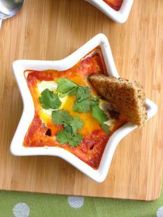 baked eggs with salsa and toast points.