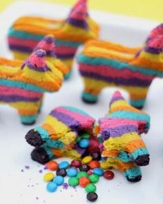 Pinata Cookies! Could also use other shapes and colored candies for different holidays. Such a fun idea.