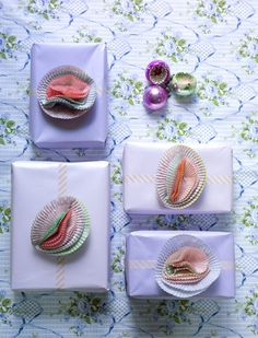 Rebecca Newport  **Cupcake sleeves for bows! Love it!