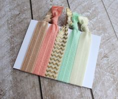 Items similar to Set of 5 Elastic Hair Ties in Tan, Peach, Gold Metallic Chevron, Pastel Green, and Ivory on Etsy Elastic Hair Ties, Coordinating Colors, Bridesmaid Gifts, Stocking Stuffers, Straw Bag, Chevron, Color Coordination, Metallic, Reusable Tote Bags