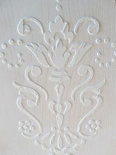 DIY: How to Create a Raised Embossed Venetian Plaster Finish on Walls or Furniture - using joint compound and a stencil. This is an easy and inexpensive project that adds so much interest to a project! Via Craftberrybush