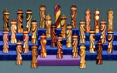 Hand Crafted Exotic Pepper Mills,  Salt Mills, Salt and Pepper Grinders and Wood Salt Cellars.  Elegant Collectibles and Functional Kitchen Art Sculptures  made from Rare Exotic Woods Of The World