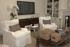 The two existing chairs were slipcovered in white linen and we added swivels underneath for easy TV watching.  Joni Webb.