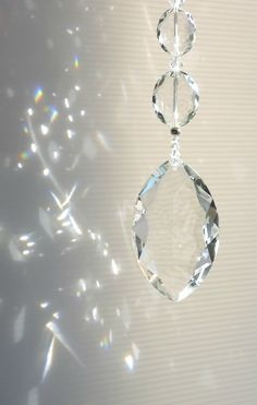 Classic marquise shape prism with graduating ovals on a strand of bi-cones. Big, elegant and great for any type of décor.