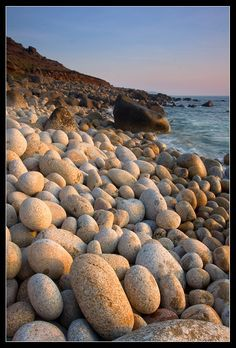 This photo from Cornwall, England is titled 'Boulder Beach'. England Ireland, England Uk, Oxford England, London England, Devon And Cornwall, Cornwall England, Beautiful Places To Visit, Beautiful World, Boulder Beach