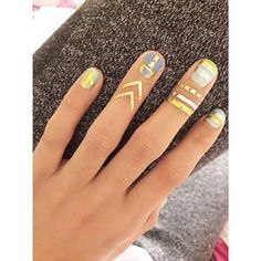 If you're into using decals and or flash tattoos, take them beyond your nail and create a faux ring motif. | 14 New Nail Art Ideas To Shake Up Your Mani