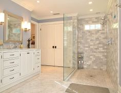 A his and hers bathroom from top to bottom: twice the sinks and showerheads.