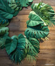 Get Your Party Sizzlin' with This Tropical Paper Leaf Garland! - - If you're hosting a scorchin' summer party, then you'll definitely want this tropical leaf garland on your decor to-do list! Magnolia Leaf Garland, Fall Leaf Garland, Diy Garland, Paper Garlands, Paper Decorations, Garland Ideas, Felt Leaves, Paper Leaves, Plant Leaves