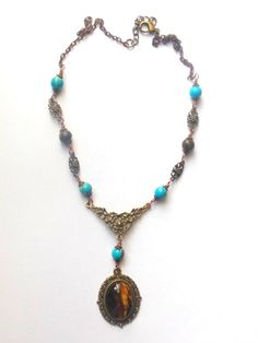 Bronze, turquoise colour necklace with tigers eye stone pendant.
