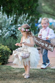 flower girl with flower halo (flower crown) and ring barrier carrying here comes the bride sign http://www.itgirlweddings.com/blog/romantic-wedding-inspiration