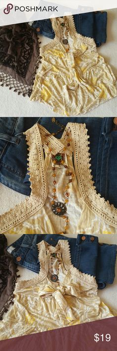 Free People top Adorable FP top for sale  Size small , very soft to the tuch  Two strap that you can tie in the front , crochet around arms , very flowie Free People Tops