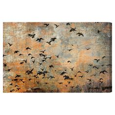 Hand-stretched canvas print featuring a silhouetted flock of birds in flight. Made in the USA.  Product: Canvas print