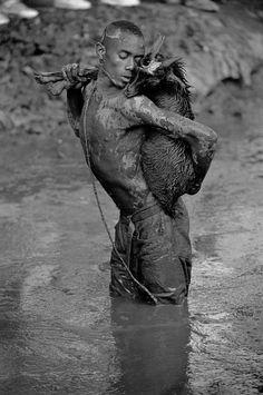 Cristina Garcia Rodero HAITI. Plaine du Nord. Near the Cap Haitien. 2000. Pilgrimage to honour the apostle Saint James (Santiago) who is at the same time the Lwa Ogou, god of war. In this region took place...