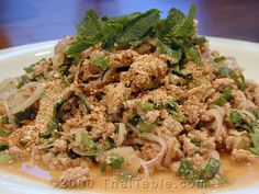 Laab, also known as Larb and Laap, is a northeastern food. It usually eaten as a part of a set (laab, papaya salad and sticky rice.) The set is accompanied by string beans, sliver of cabbage, water spinach and Thai basil. It can be served as an appetizer. It can also be served as a main course along with other non-northeastern food.
